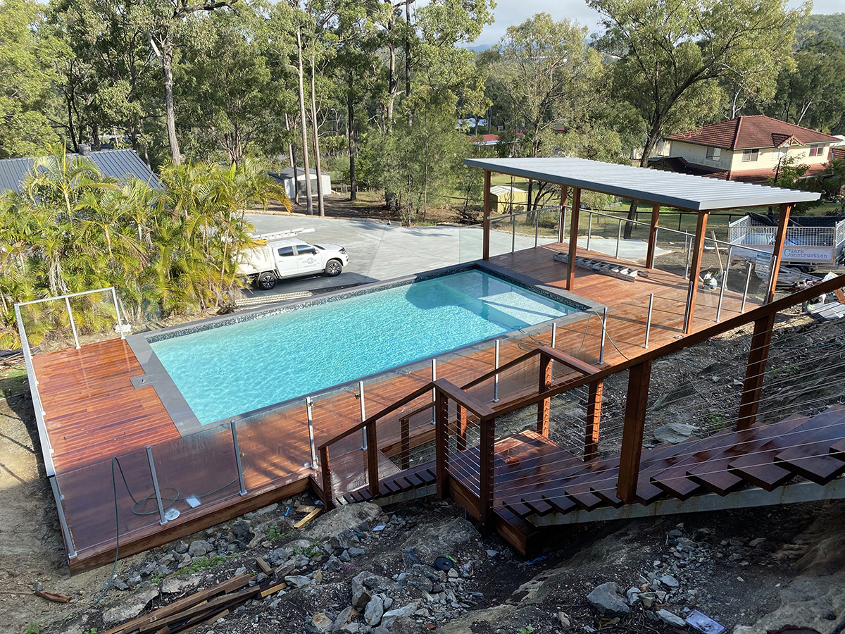 Pool surround wooden decking with stairs builder gold coast